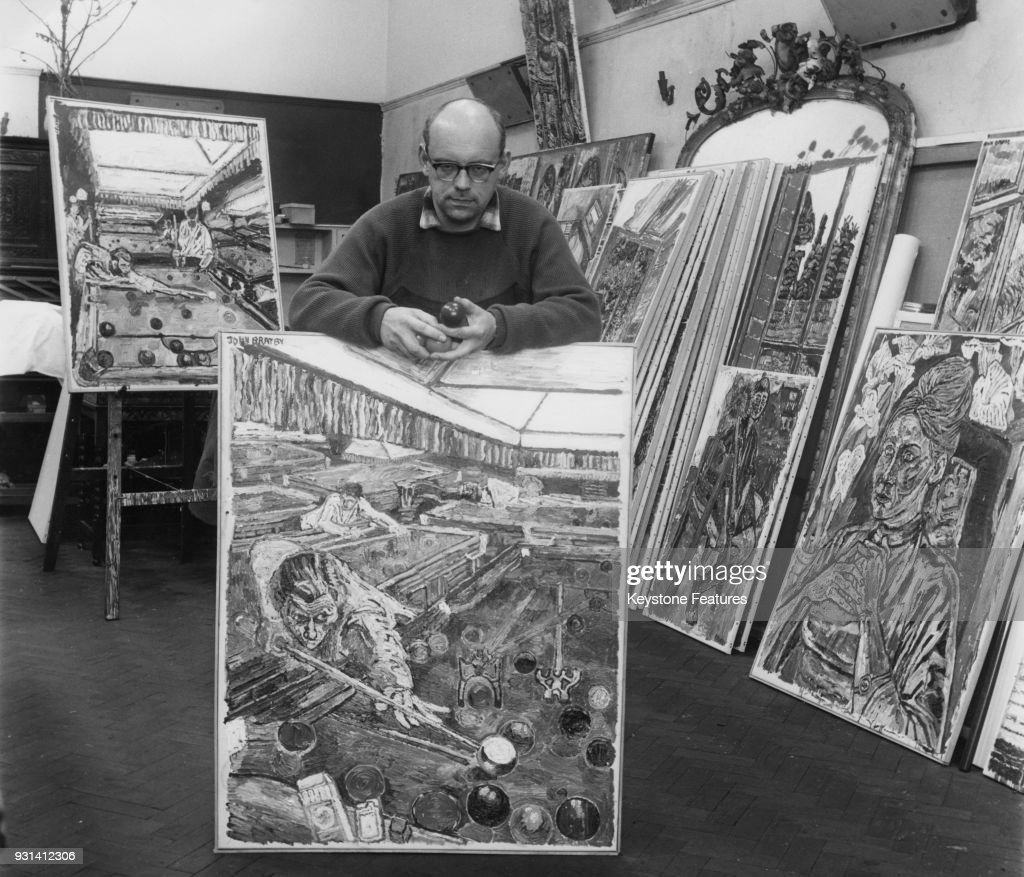 English painter John Bratby with some of his works in the \'kitchen ...