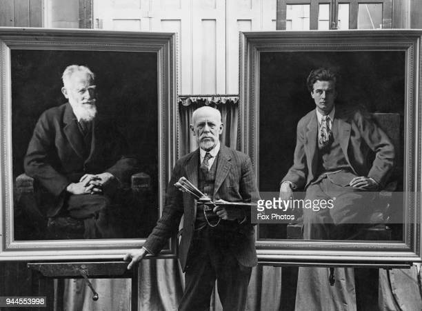 English painter John Collier with his portraits of George Bernard Shaw and Aldous Huxley circa 1931 The first was rejected by the Royal Academy and...