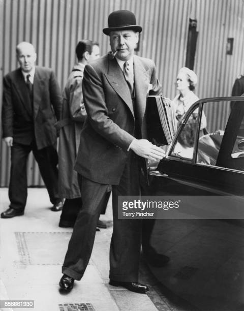 English pathologist Francis Edward Camps arrives at the Old Bailey in London for the second day of the trial of serial killer John Reginald Christie...