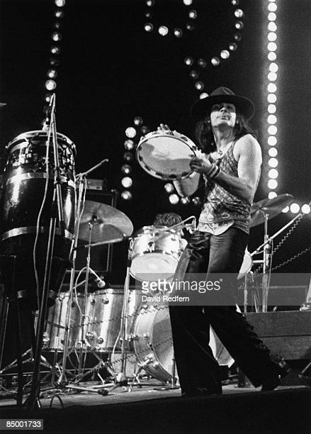 English percussionist Mickey Finn of British glam rock group T. Rex performs live on stage during one date of the band's tour of the United Kingdom...
