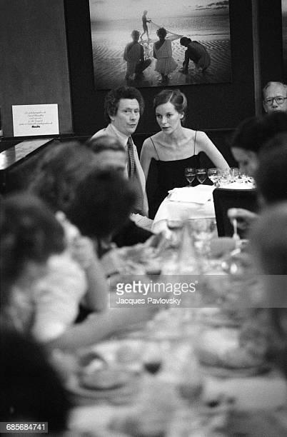 English photographer and film director David Hamilton and his companion and Muse, Mona Kristensen, celebrate the premiere of Hamilton's first film,...