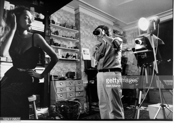 English photographer David Bailey focusing on fashion model Marie Helvey London UK August 8th 1977