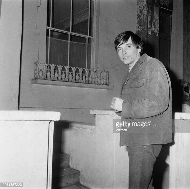 English photographer David Bailey outside his home at 177 Gloucester Avenue in Primrose Hill, London, 13th February 1966.