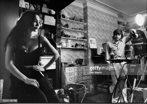 English photographer David Bailey photographing fashion model Marie Helvey at home in London August 8th 1977