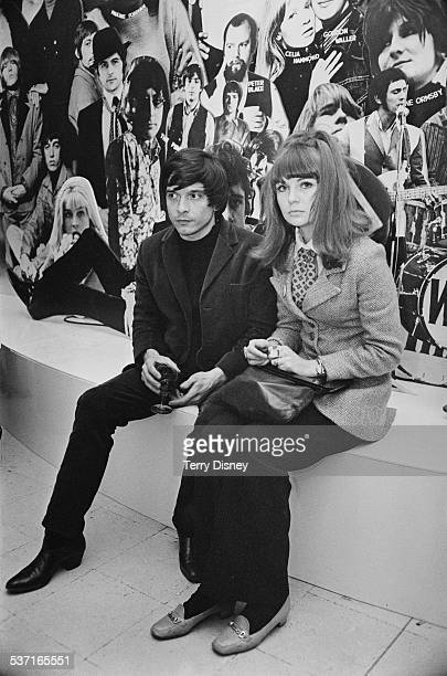English photographer David Bailey with English model and actress Chrissie Shrimpton at Madame Tussauds London 21st March 1967