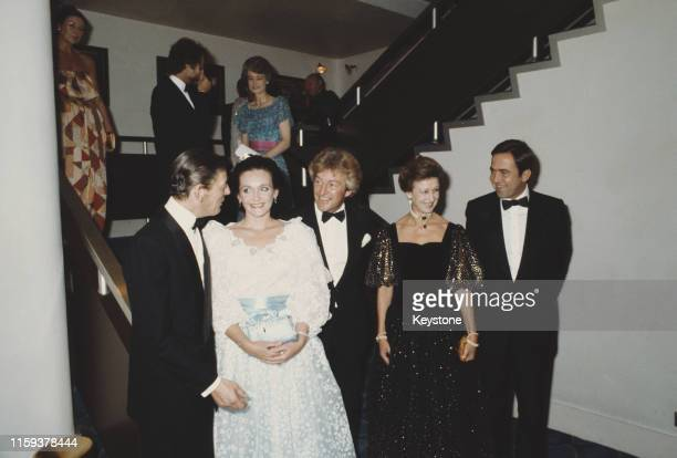 English photographer Lord Lichfield and his guests arrive at a charity ball to launch his new book 'The Most Beautiful Women' UK September 1981