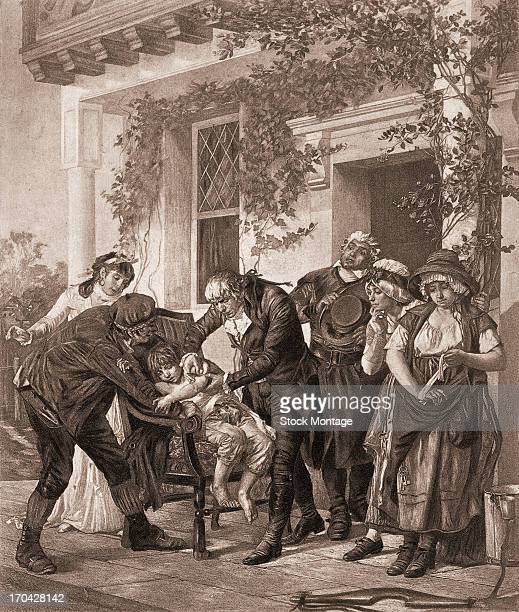 English physician Edward Jenner administers a smallpox vaccine to a child late 1790s or early 1800s