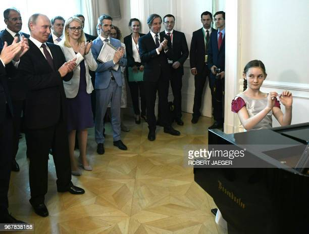 English pianist Alma Deutscher performs for Russian President Vladimir Putin in Vienna Austria on June 5 2018 / Austria OUT
