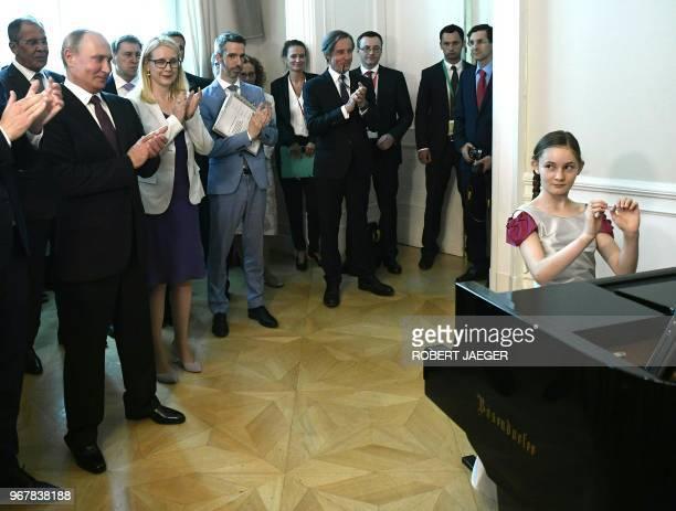 English pianist Alma Deutscher performs for Russian President Vladimir Putin in Vienna Austria on June 5 2018 / Austria OUT