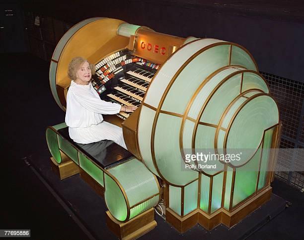 English pianist Ena Baga plays a theatre organ as an accompaniment to silent films circa 1995