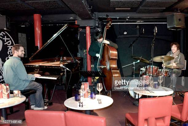 English pianist Kit Downes performs live on stage with his trio at PizzaExpress Jazz Club in Soho London on 5th December 2013