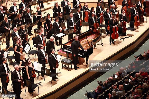 English pianist Stephen Hough prepares plays the piano as Finnish conductor Osmo Vanska leads the London Philharmonic Orchestra in composer Antonin...