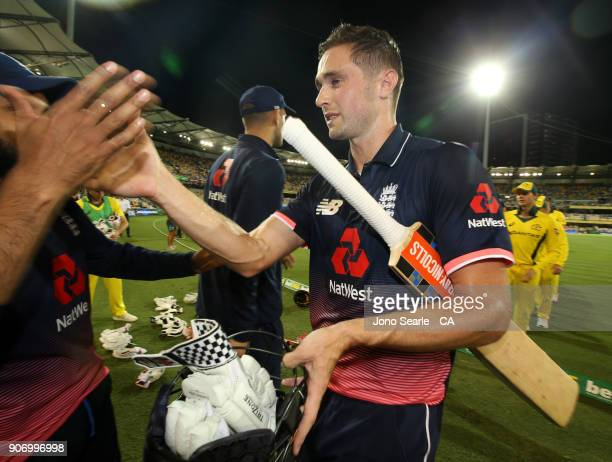 English player Chris Woakes celebrates the win with team mates during game two of the One Day International series between Australia and England at...