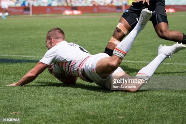 English player Tom Mitchell scores a try in their game against Papua New Guinea at the World Rugby Sevens Series at Allianz Stadium in Sydney on...