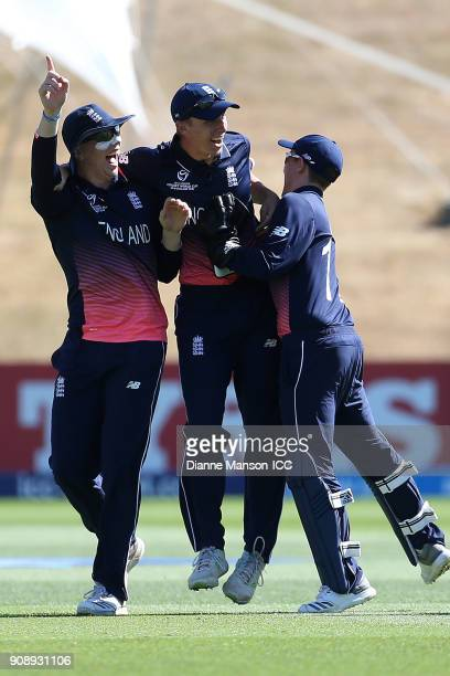 English players celebrate the dismissal of Param Uppal of Australia during the ICC U19 Cricket World Cup Quarter Final match between England and...