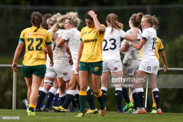 English players celebrate the try of Sarah McKenna during the Women's International Test match between the Australian Wallaroos and the England Roses...