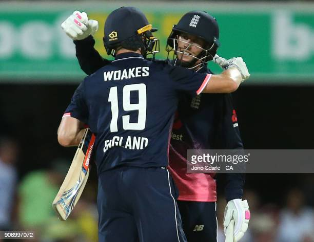 English players Chris Woakes and Joe Root celebrate the win during game two of the One Day International series between Australia and England at The...