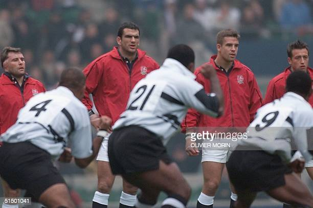 English players Darren Garforth, Martin Johnson, Joe Worsley and Dan Luger watch Samoan players perform the Haka before the Rugby World Cup...