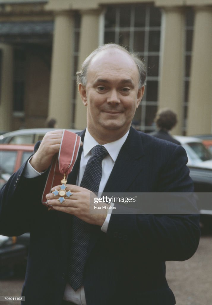 English playwright Alan Ayckbourn receives his CBE at Buckingham Palace, London, 11th February 1987.