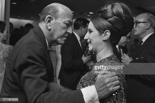 English playwright and actor Noël Coward with American singer and actress Barbra Streisand in London, England, 12th June 1966.