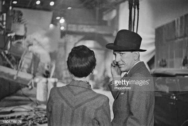 English playwright and film director Noel Coward on set during production of the Two Cities Films war film 'In Which We Serve' at Denham Studios in...