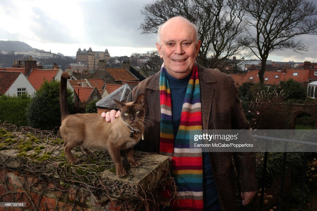 English playwright and theatre director Sir Alan Ayckbourn with a pet cat at his home in Scarborough, North Yorkshire, March 2014.