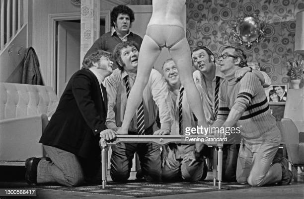 English playwright Colin Welland watches the cast rehearsing a scene from his play 'Say Goodnight To Grandma' at the St Martin's Theatre in London,...