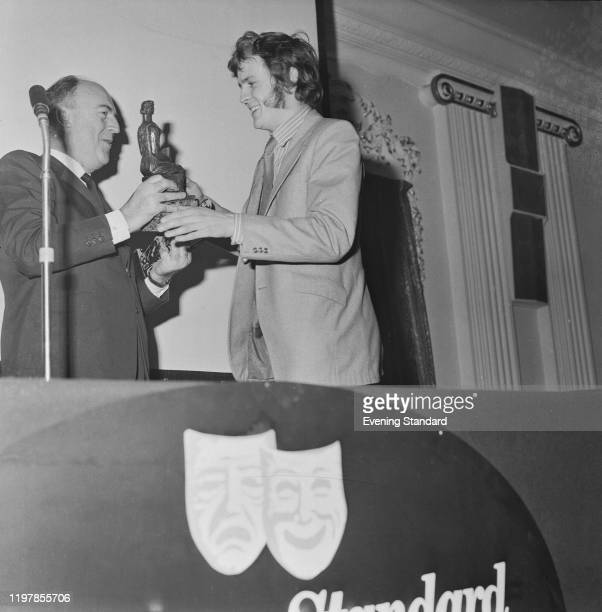English playwright David Hare is presented with the Most Promising Playwright Award by theatre critic Philip Hope-Wallace at the 1970 Evening...