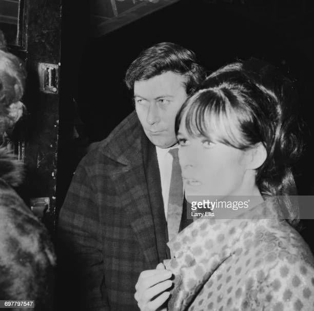 English playwright John Osborne and a friend attend the first night of the play 'Dr Faustus' starring Elizabeth Taylor and Richard Burton UK 16th...