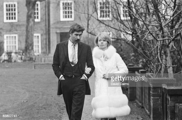 English playwright John Osborne out walking in Chelsea Square with his girlfriend actress Jill Bennett 13th December 1967