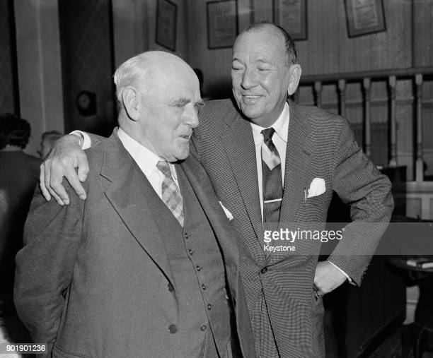 English playwright Noël Coward chats to actor Sir Lewis Casson at the Cambridge Theatre, UK, 29th July 1960. Coward is meeting the cast line-up for...
