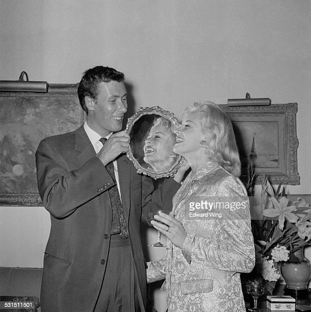 English playwright, screenwriter, and actor John Osborne and his wife Scottish stage and film actress Mary Ure at a presentation given to the couple...