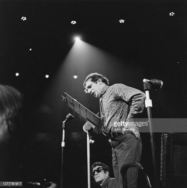 English poet Christopher Logue performs at the New Moon Carnival of Poetry in The Round at the Royal Albert Hall in London 18th June 1966