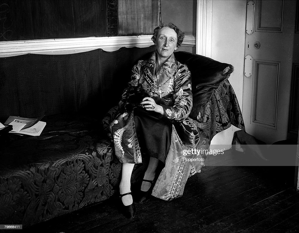 English poet Edith Sitwell at home in her flat in Kensington, 1928.