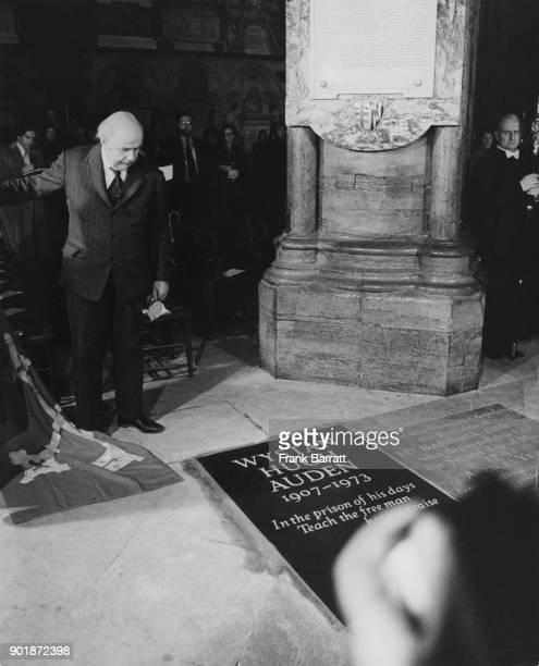 English Poet Laureate John Betjeman unveils a memorial to fellow poet W H Auden in Poets' Corner in Westminster Abbey London 2nd October 1974