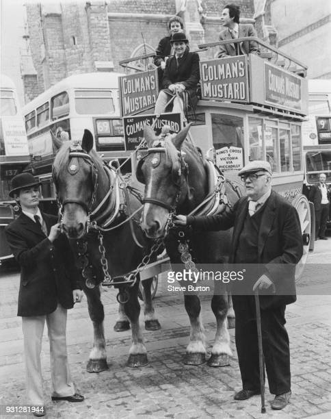 English Poet Laureate Sir John Betjeman arrives at the Guildhall in London on a horsedrawn bus to celebrate 150 years of the London Bus Service 2nd...
