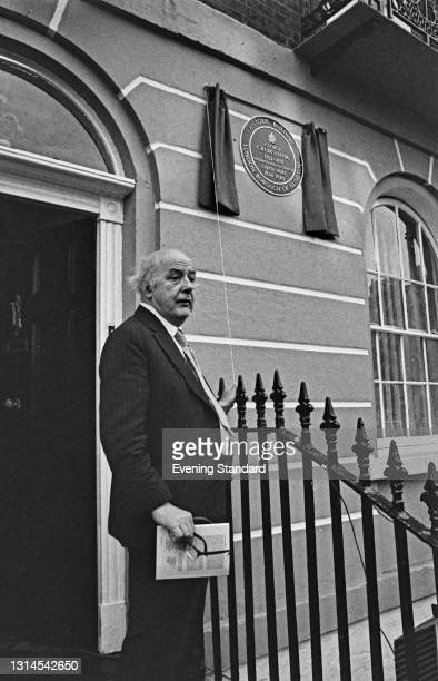 English poet Sir John Betjeman unveils a green plaque on Amwell Street in Islington, London, to commemorate the fact that illustrator George...