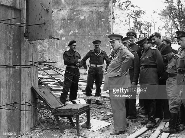English politician and Prime Minister Winston Churchill inspecting a chair once used by Adolf Hitler during a tour of the ruins of the Chancellory in...