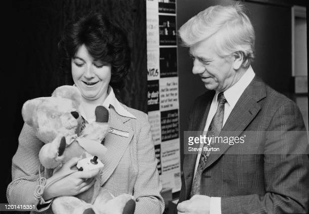 English politician Jack Ashley watches a demonstration of a new teddy bear toy designed especially for deaf children at the National Deaf Children's...