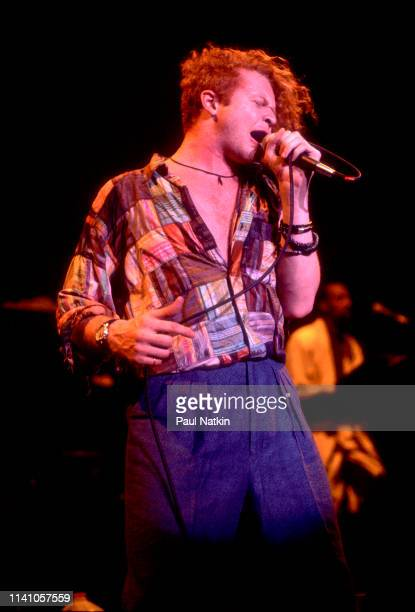 English Pop and RB singer Mick Hucknall of the group Simply Red performs onstage at the Park West Chicago Illinois August 5 1986