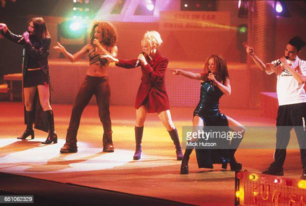 English pop girl group The Spice Girls performing at the Smash Hits Poll Winners' Party at the London Arena 1st December 1996 Left to right Victoria...