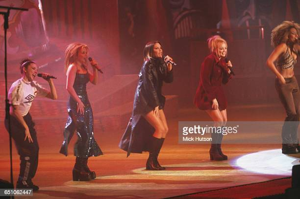 English pop girl group The Spice Girls performing at the Smash Hits Poll Winners' Party at the London Arena 1st December 1996 Left to right Melanie...