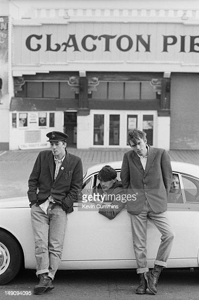 English pop group Blur pose with a Jaguar Mark 2 car by Clacton Pier in ClactononSea Essex March 1993 Left to right guitarist Graham Coxon bassist...