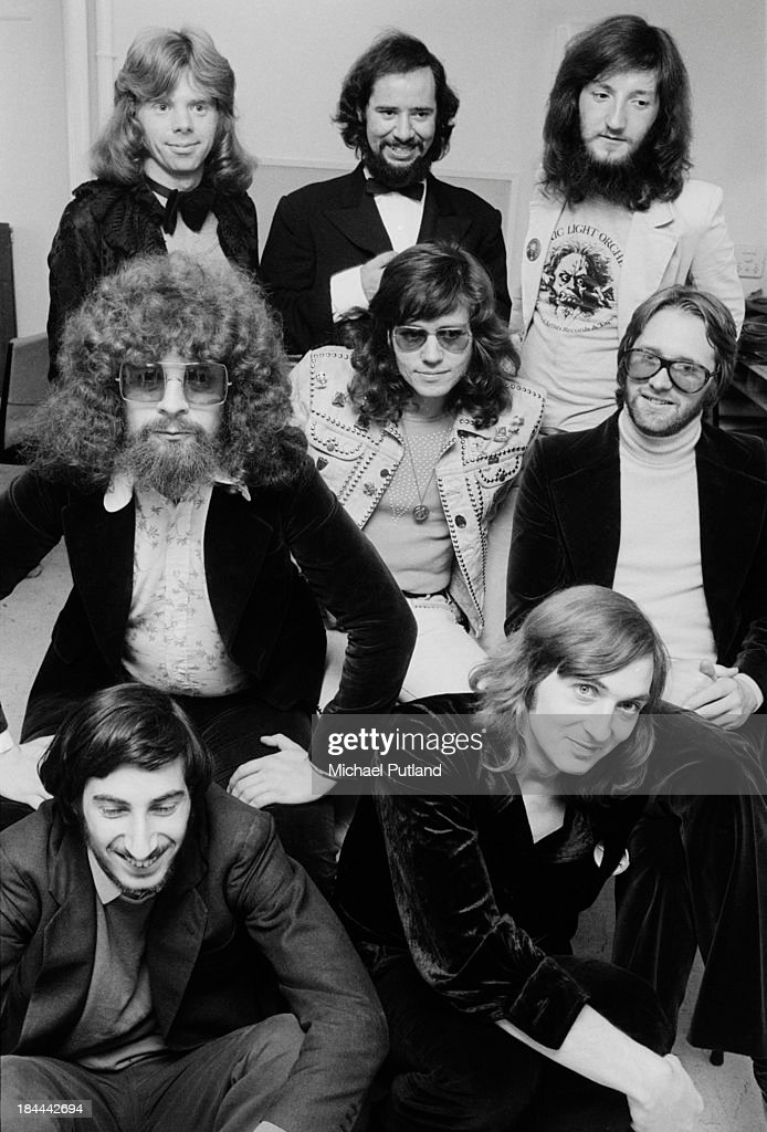 English pop group Electric Light Orchestra (ELO) in a BBC dressing room before an appearance on the TV music show 'Top Of The Pops', London, 11th October 1973. The band will be miming to their single 'Showdown'. Back row, left to right: sound engineer Rick Pannell, Mike Edwards (1948 - 2010) and Mik Kaminski. Middle row: Jeff Lynne, Bev Bevan and Mike de Albuquerque. Front: unknown, Richard Tandy.