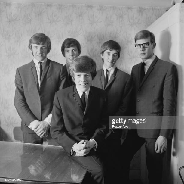 English pop group Herman's Hermits featuring from left Karl Green Barry Whitwam Peter Noone Keith Hopwood and Derek Leckenby posed together in...