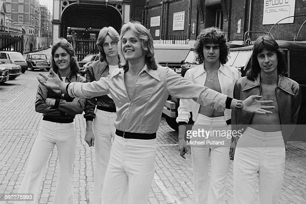 English pop group Kenny outside the Floral Hall in Covent Garden London August 1976 Left to right singer Richard Driscoll drummer Andy Walton...