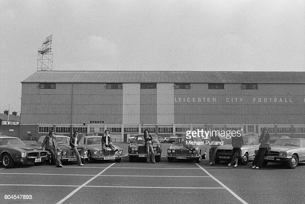 English pop group Showaddywaddy with their cars outside Filbert Street stadium home of Leicester City Football Club Leicester 11th March 1976 Left to...