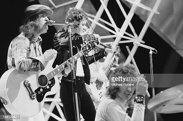 English pop group Slade performing on the BBC TV music programme 'Top Of The Pops' London 10th November 1971 Left to right Noddy Holder Jim Lea Dave...