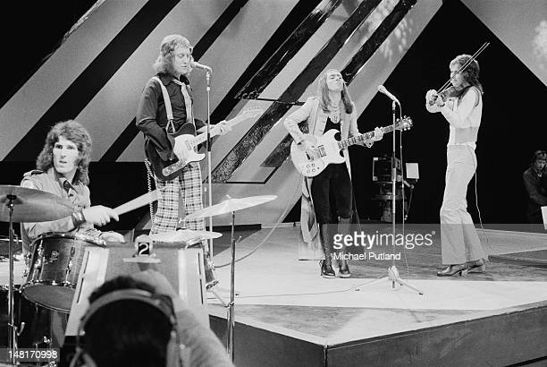 English pop group Slade performing on the Christmas edition of the BBC TV music programme 'Top Of The Pops' London December 1971 Left to right Don...