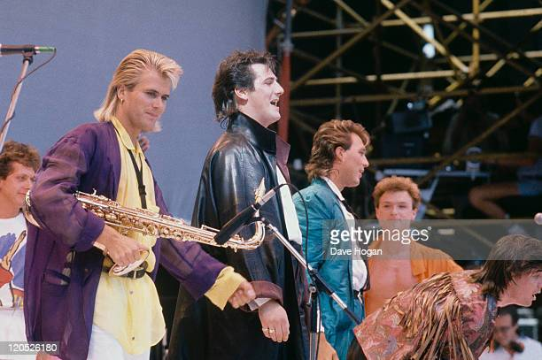 English pop group Spandau Ballet onstage at the Live Aid concert at Wembley Stadium, London, 13th July 1985. From second left: Steve Norman,Tony...